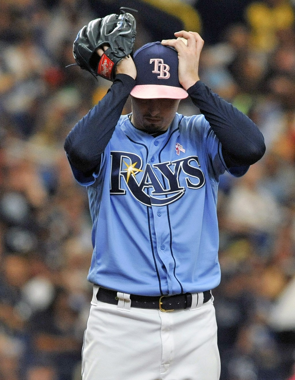 Tampa Bay Rays starter Blake Snell adjusts his cap between pitches during the fifth inning of a baseball game against the New York Yankees, Sunday, Ma
