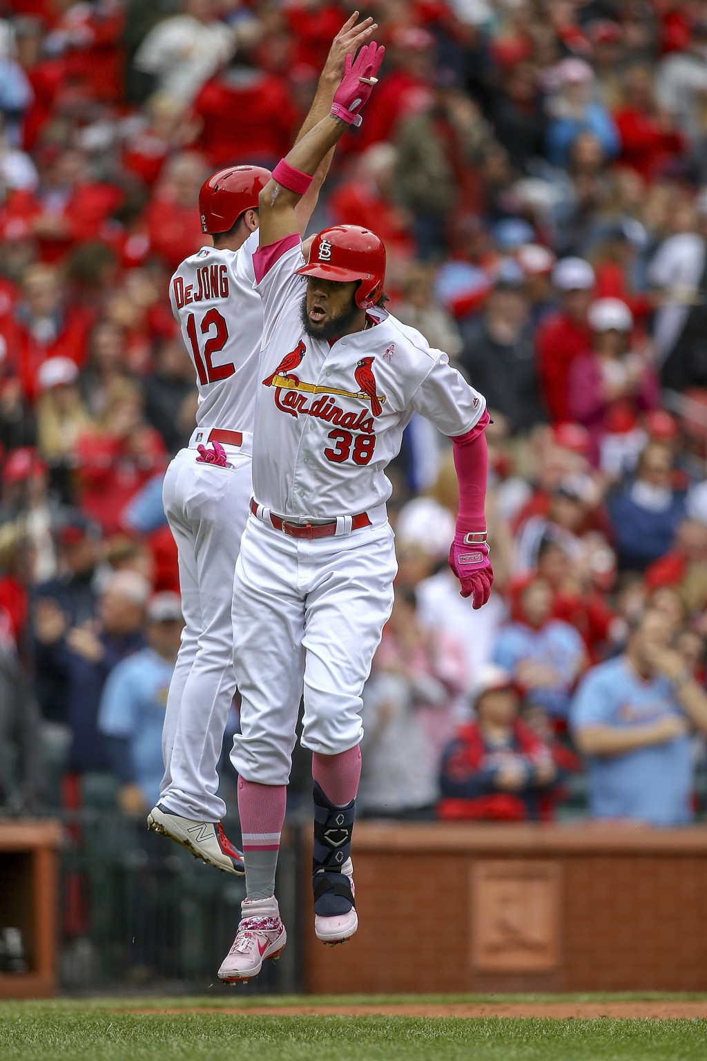 St. Louis Cardinals' Jose Martinez, right, celebrates with teammate Paul DeJong after hitting a two-run home run during the second inning of a basebal...