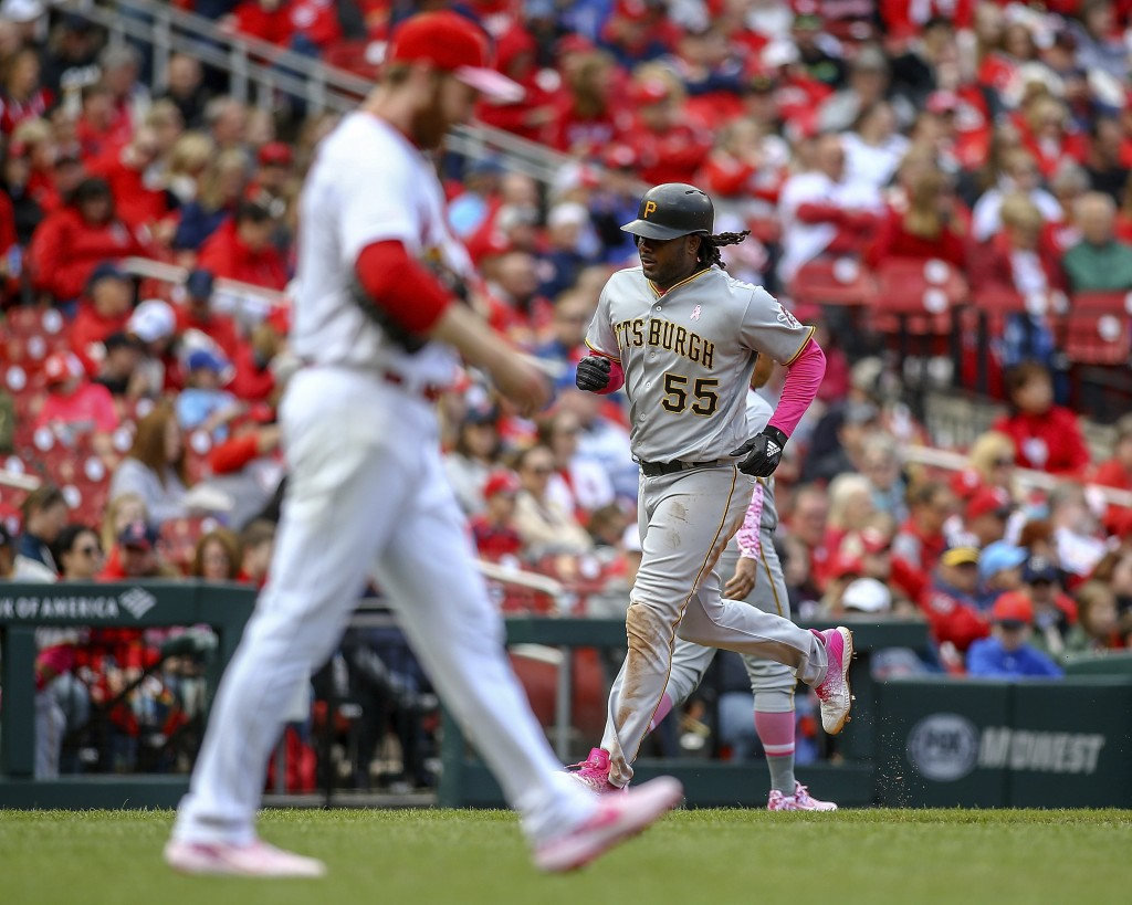 Pittsburgh Pirates' Josh Bell, right, runs the bases after hitting a three-run home run off of St. Louis Cardinals relief pitcher John Brebbia (60) du...