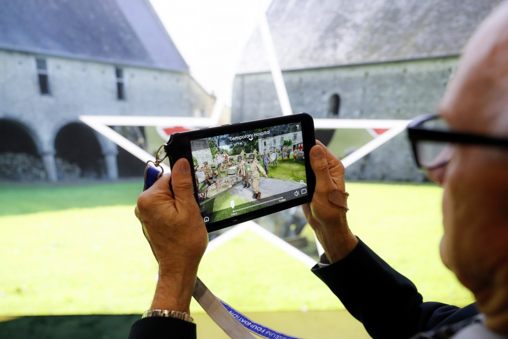 "In this Friday, May 10, 2019 photo, testing and final adjustments are made to the new ""D-Day: Freedom from Above"" interactive augmented reality exhibi..."