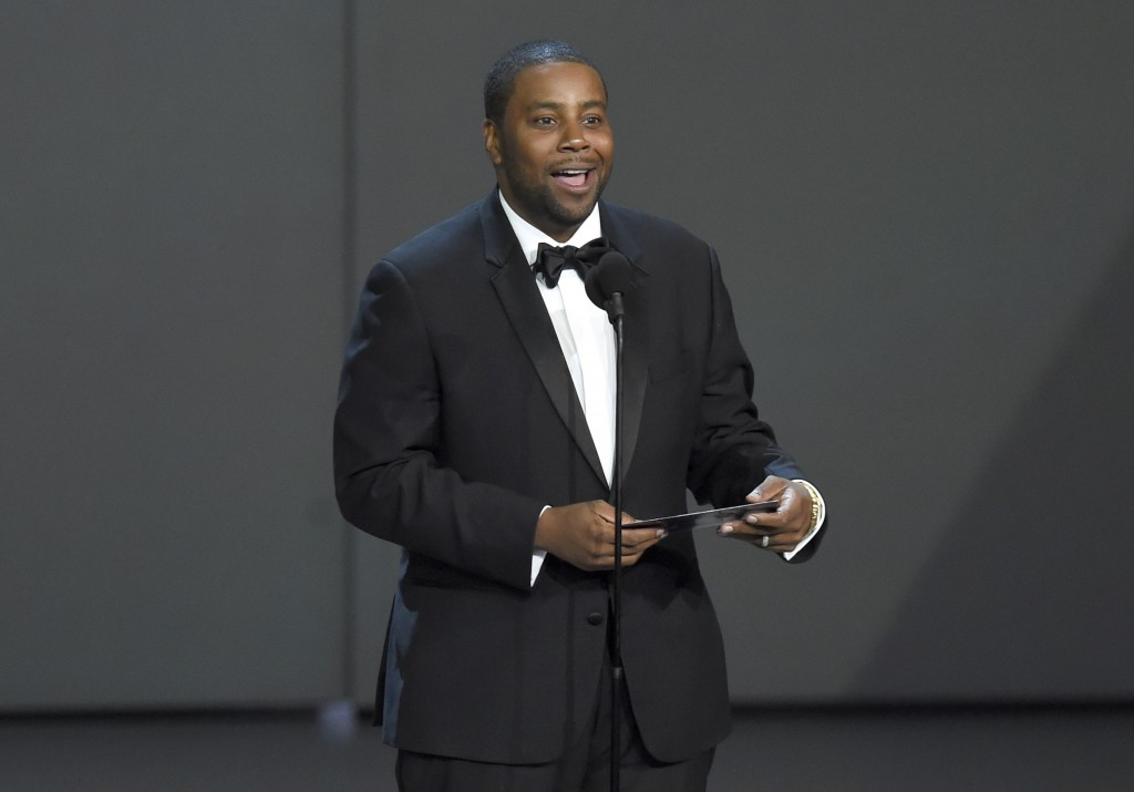 FILE - In this Sept. 17, 2018, file photo Kenan Thompson presents the award for outstanding drama series at the 70th Primetime Emmy Awards at the Micr