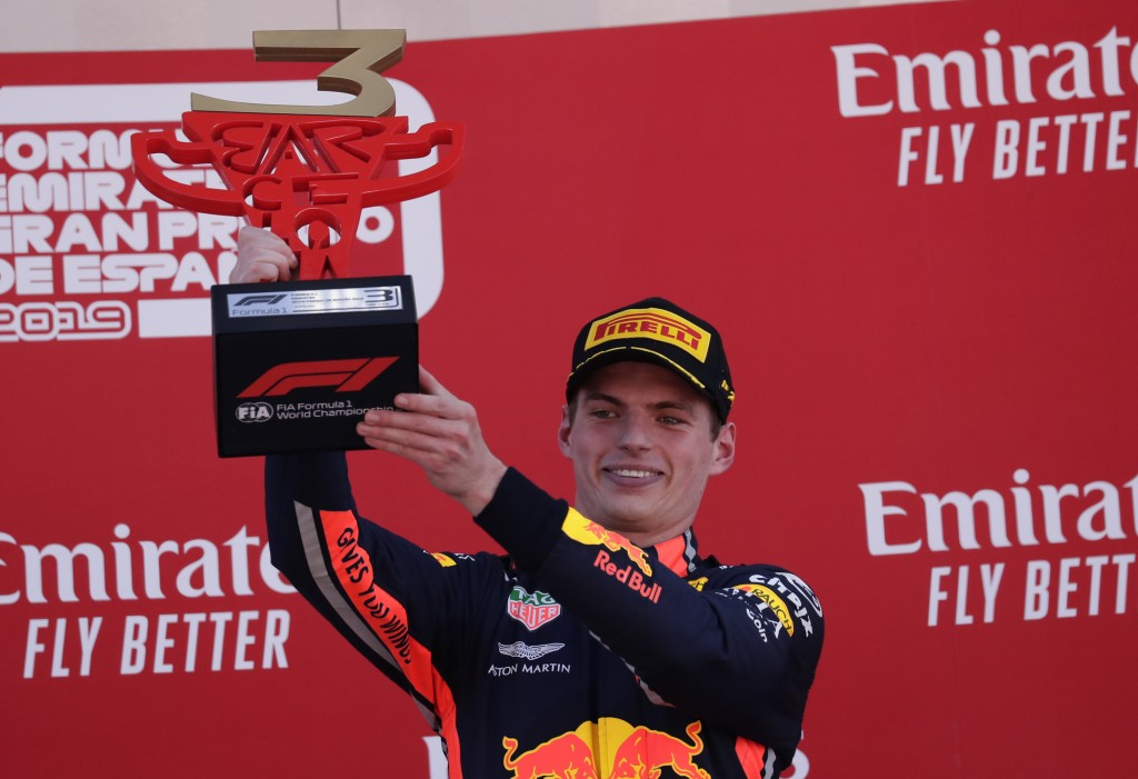 Red Bull driver Max Verstappen of the Netherland's, third place, celebrates on the podium after the Spanish Formula One race at the Barcelona Cataluny