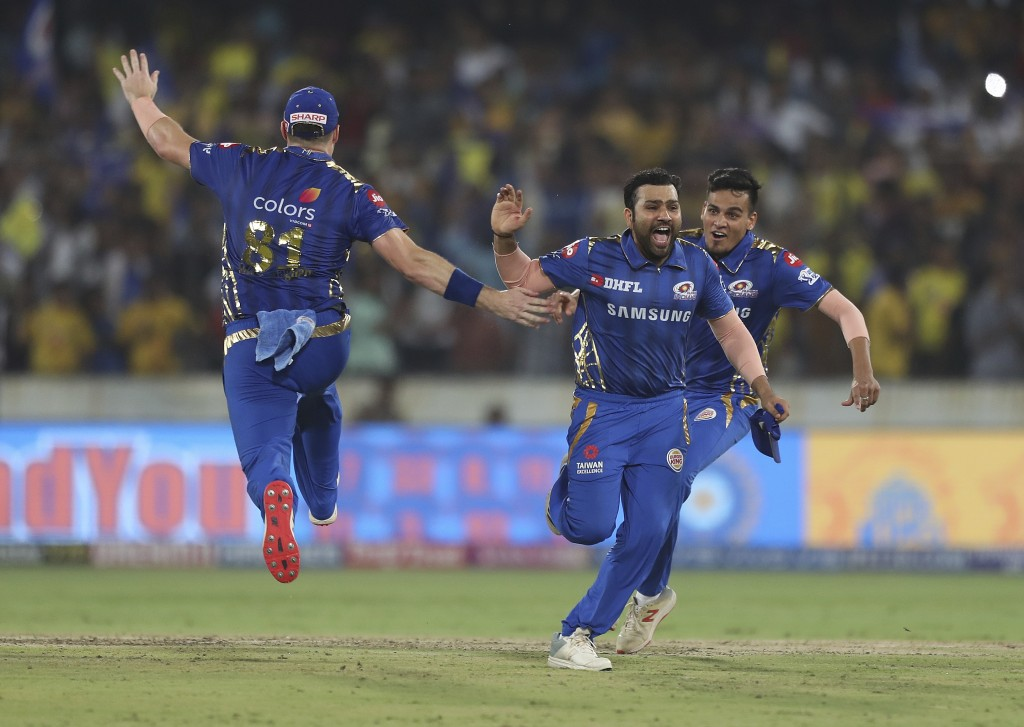 In this Sunday, May 12, 2019, file photo, Mumbai Indians captain Rohit Sharma, second right, and teammates celebrate their win in the VIVO IPL T20 cri