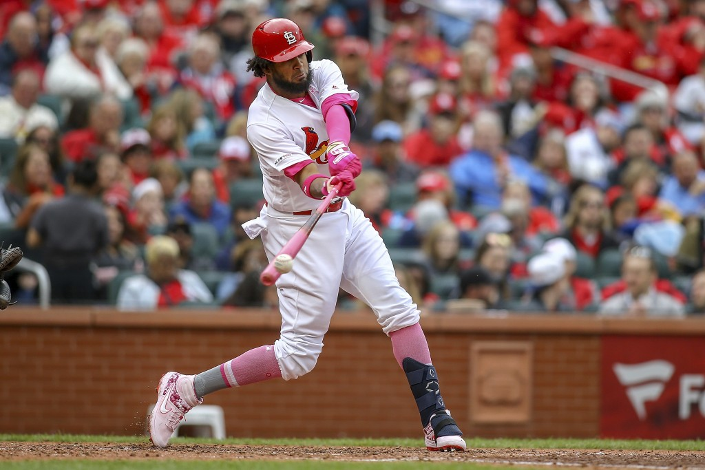 St. Louis Cardinals' Jose Martinez hits a single during the fourth inning of a baseball game against the Pittsburgh Pirates Sunday, May 12, 2019, in S