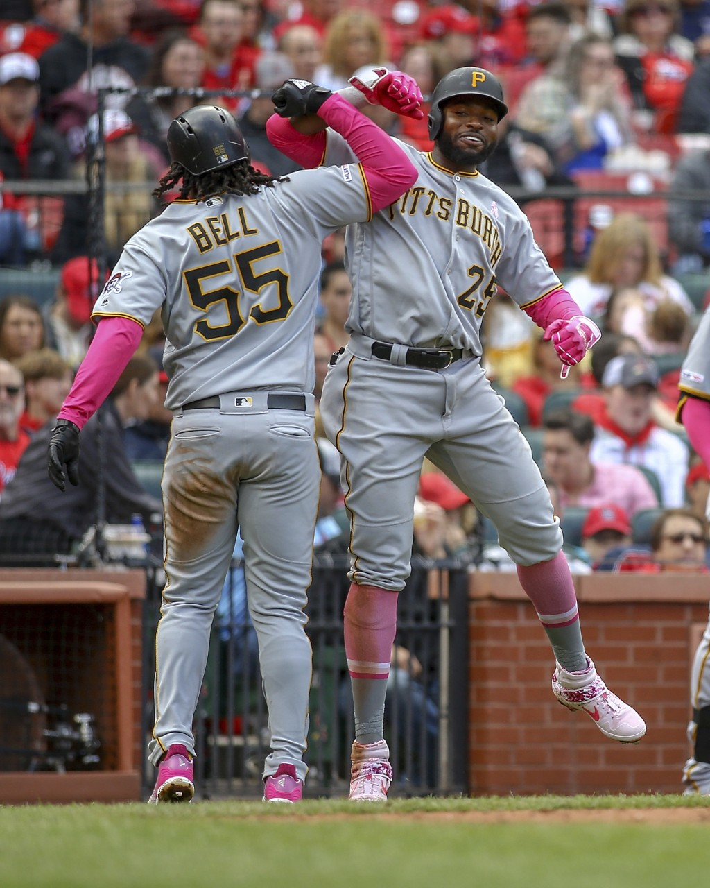 Pittsburgh Pirates' Josh Bell, left, celebrates with teammate Gregory Polanco after hitting a three-run home run during the seventh inning of a baseba...