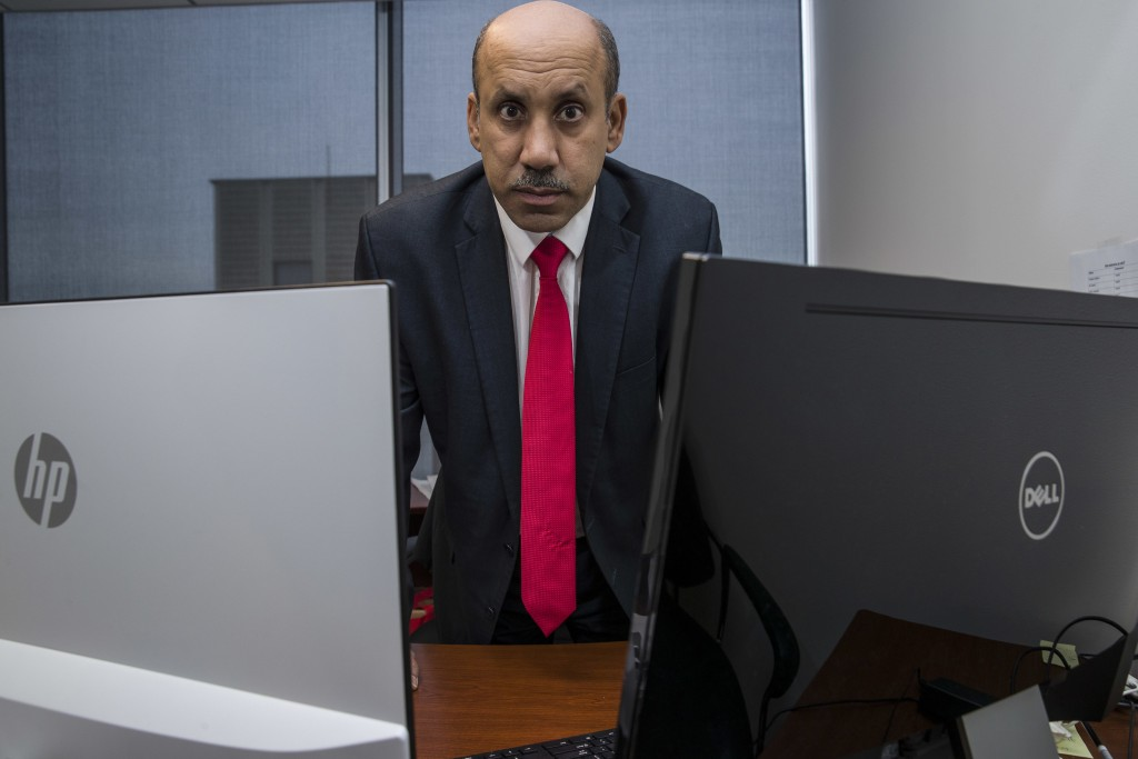 FILE - In this Oct. 26, 2018, file photo Ali AlAhmed poses for a photograph in his office in Washington. Citizen Lab says a fake Twitter account unmas