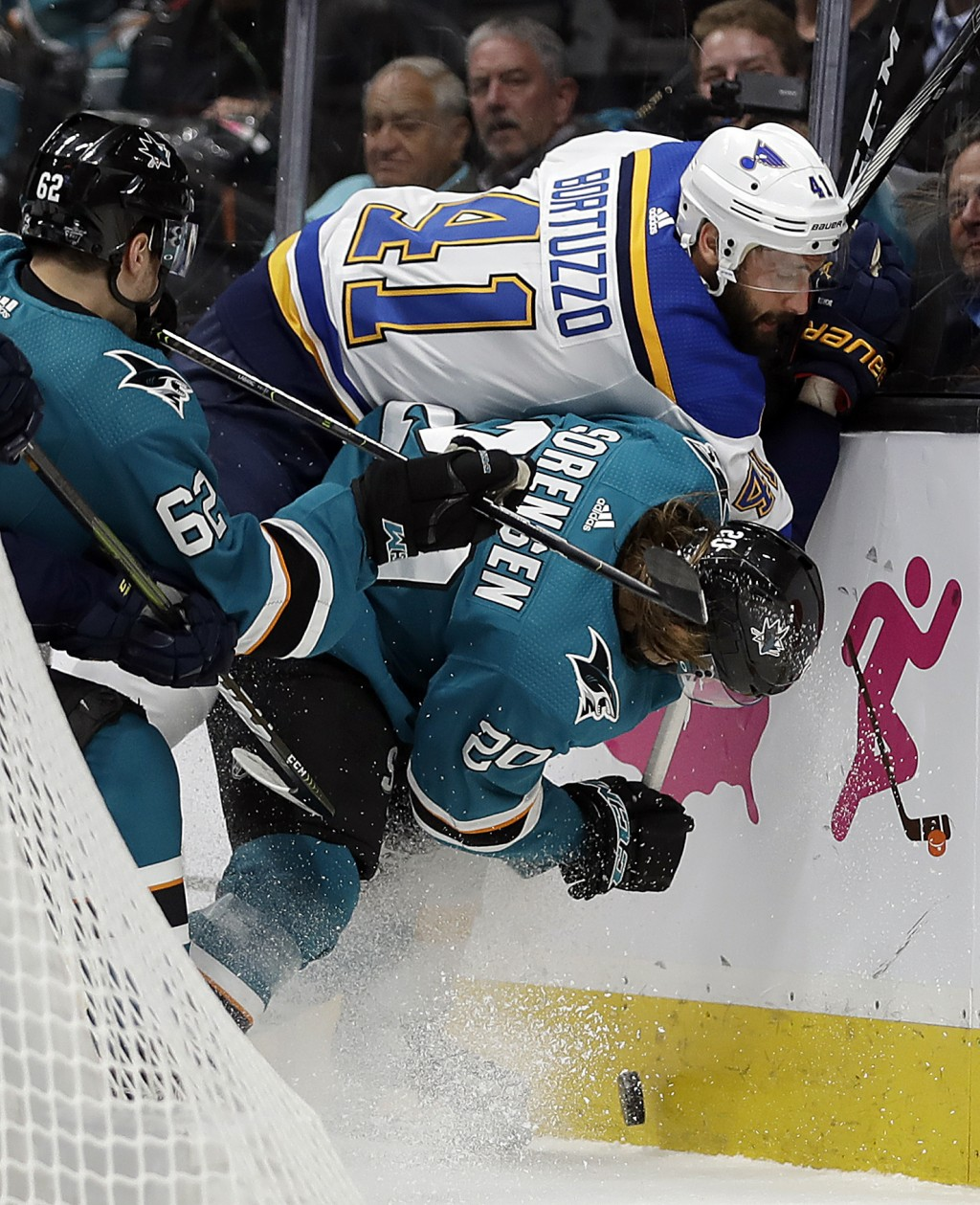 St. Louis Blues' Robert Bortuzzo (41) fights for the puck with San Jose Sharks' Kevin Labanc, left, and Marcus Sorensen (20) during the first period i