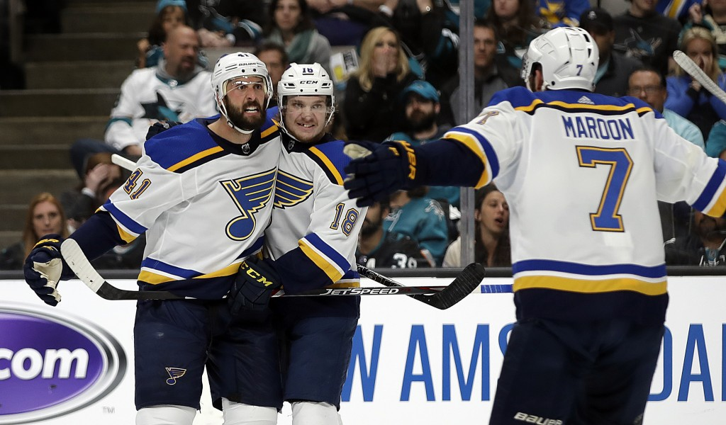 St. Louis Blues' Robert Bortuzzo, left, celebrates with teammates Robert Thomas (18) and Pat Maroon (7) after scoring a goal against the San Jose Shar