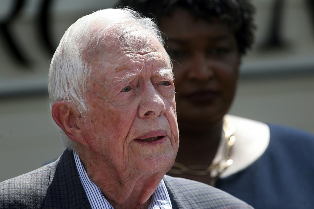 FILE- In this Sept. 18, 2018 file photo, former President Jimmy Carter speaks during a news conference, in Plains, Ga. A spokeswoman says former U.S.
