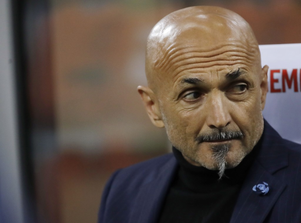 Inter Milan coach Luciano Spalletti sits on the be...