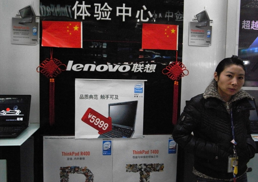 FILE - In this Jan 8, 2009, file photo, a vendor waits for customers at a computer shop selling Lenovo laptops in Beijing, China. U.S. trade officials