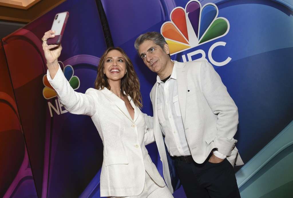 """Arielle Kebbel, left, and Michael Imperioli, from the cast of """"Lincoln,"""" take a selfie as they attend the NBC 2019/2020 Upfront at The Four Seasons Ne..."""