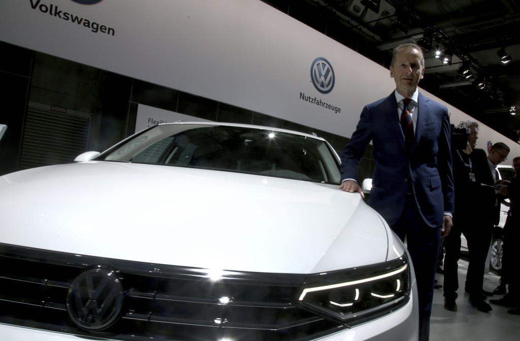Herbert Diess, CEO of the Volkswagen stock company, poses next to a Volkswagen car prior to the company's annual general meeting in Berlin, Germany, T