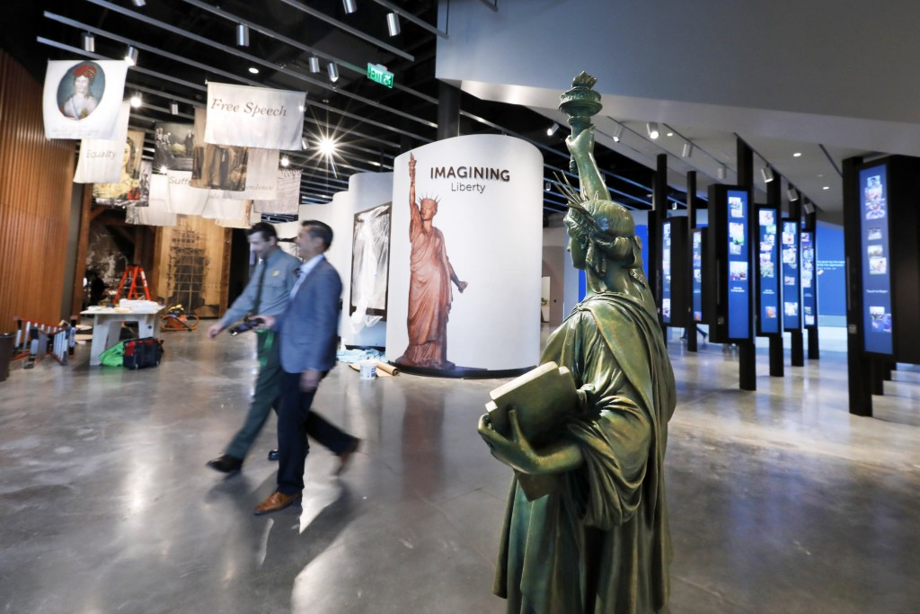 A miniature Statue of Liberty is among the artifacts displayed in the new Statue of Liberty Museum, on Liberty Island, in New York, Monday, May 13, 20...