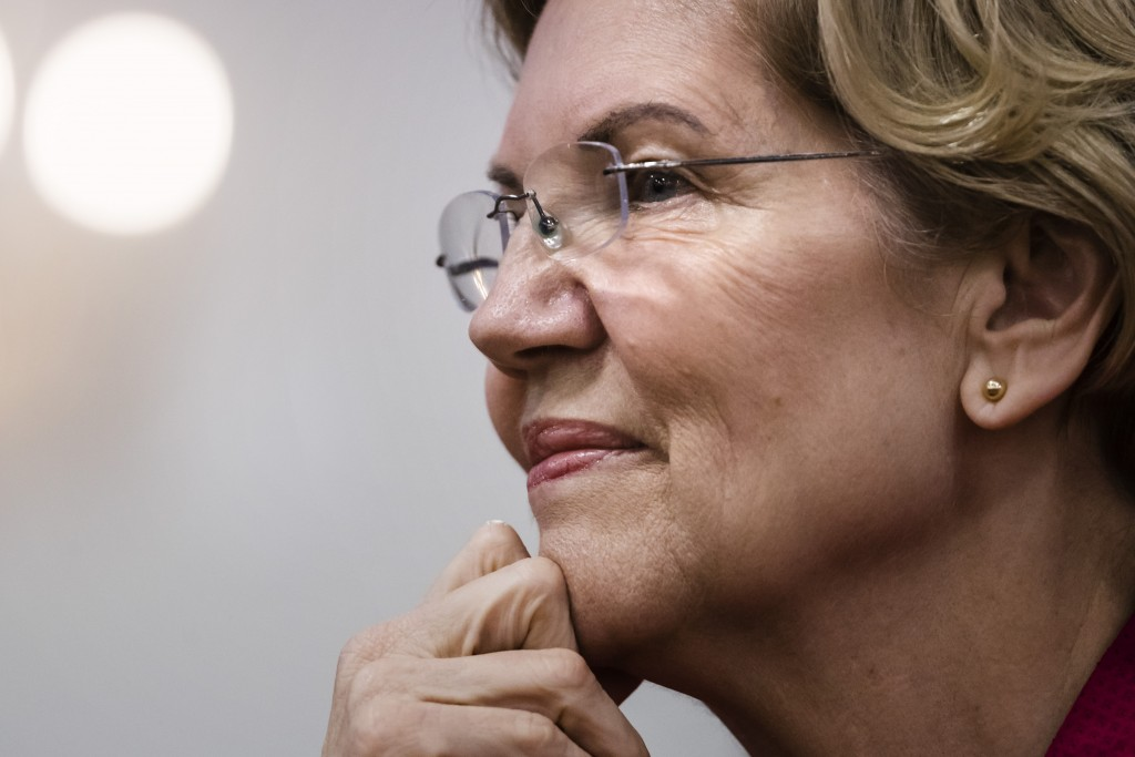 Democratic presidential candidate Sen. Elizabeth Warren, D-Mass., listens during an American Federation of Teachers town hall event, at the Plumbers L