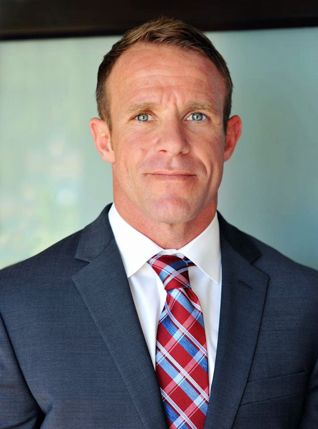 FILE - This 2018 file photo provided by Andrea Gallagher shows her husband, Navy SEAL Edward Gallagher, who has been charged with murder in the 2017 d