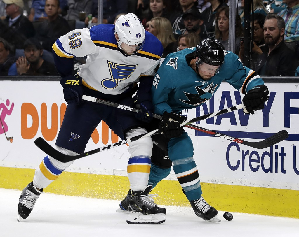 St. Louis Blues' Ivan Barbashev, left, and San Jose Sharks' Justin Braun fight for the puck during the second period in Game 2 of the NHL hockey Stanl