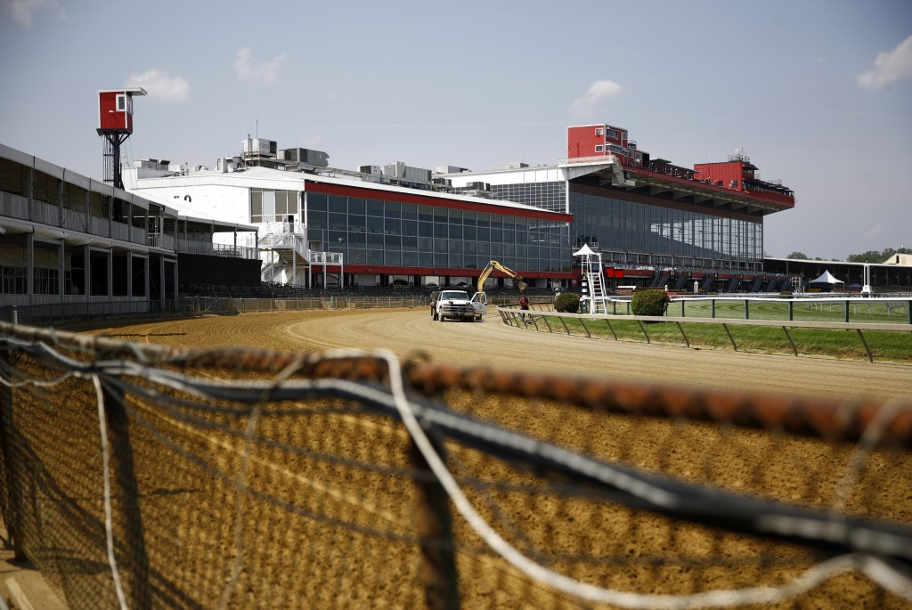 FILE - In this May 15, 2018, file photo, preparations take place for the Preakness Stakes horse race at Pimlico Race Course in Baltimore. The future o...