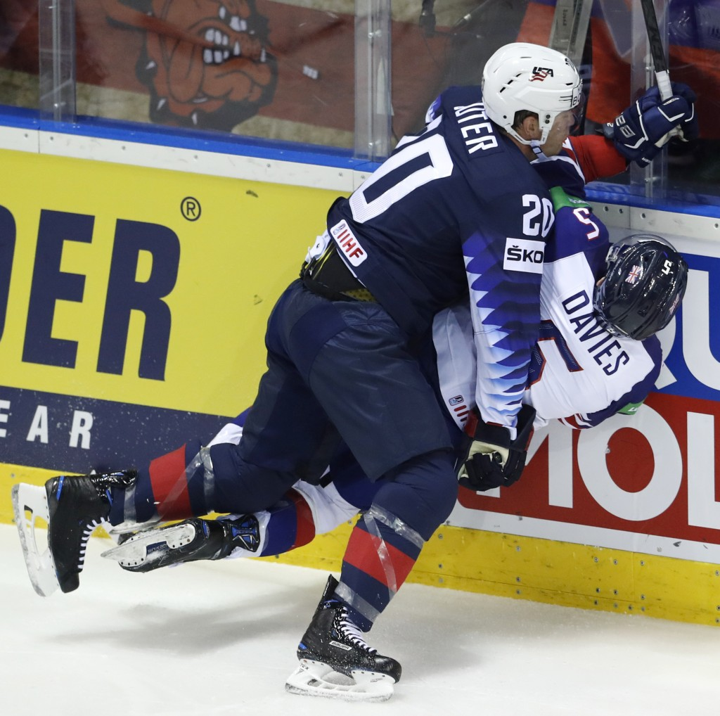 Ryan Sutter of the US, left, checks Great Britain's Ben Davies, right, during the Ice Hockey World Championships group A match between the United Stat