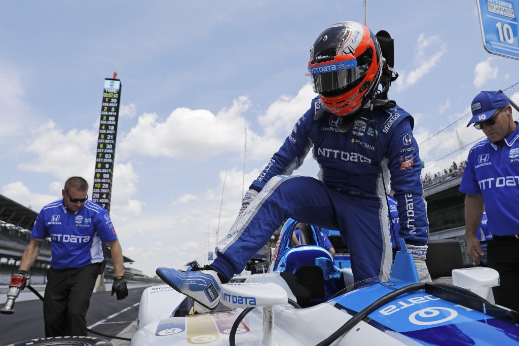 Felix Rosenqvist, of Sweden, steps out of his car during practice for the Indianapolis 500 IndyCar auto race at Indianapolis Motor Speedway, Tuesday,