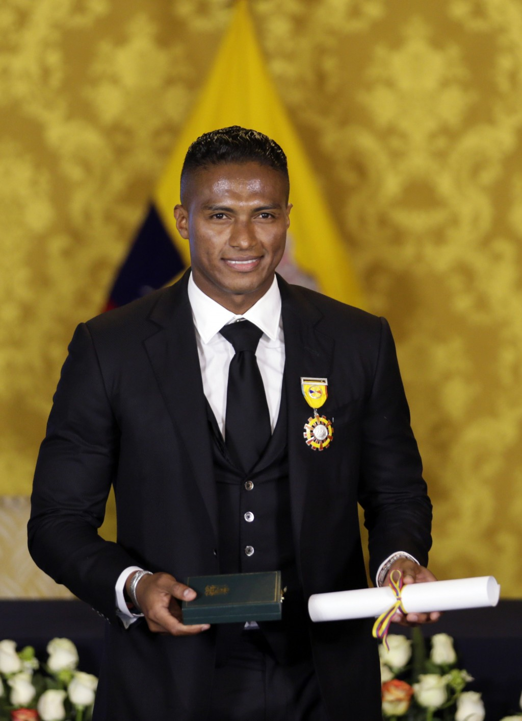 Soccer star Antonio Valencia poses for a photo after a ceremony in which the fullback was decorated with a National Order of Merit, in Quito, Ecuador,