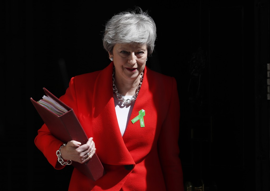 Britain's Prime Minister Theresa May leaves 10 Downing Street for her weekly Prime Minister's Questions in the House of Commons in London, Wednesday,