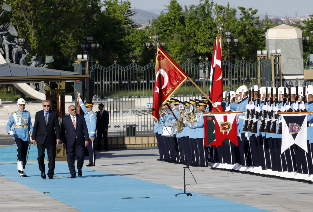 Turkish President Recep Tayyip Erdogan, left, and Iraqi Prime Minister Adel Abdul-Mahdi inspect an honour guard during a welcome ceremony, in Ankara,