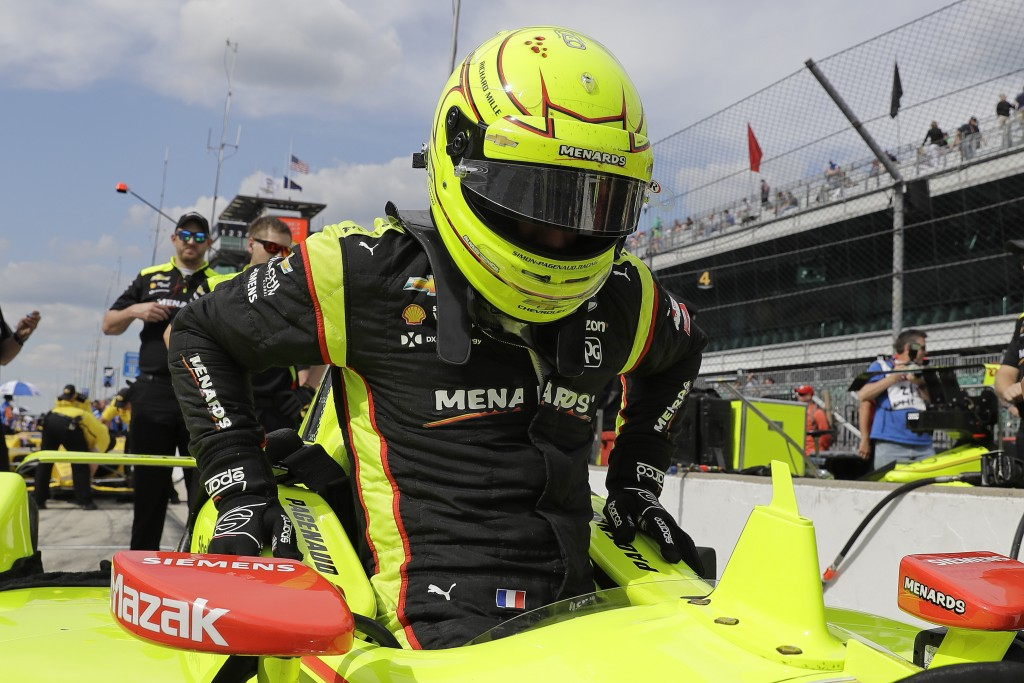 Simon Pagenaud, of France, climbs into his car during practice for the Indianapolis 500 IndyCar auto race at Indianapolis Motor Speedway, Tuesday, May