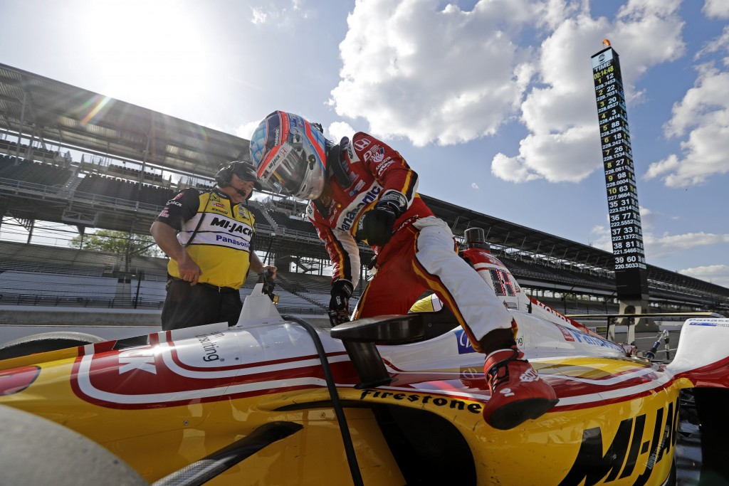 Takuma Sato, of Japan, climbs out of his car during practice for the Indianapolis 500 IndyCar auto race at Indianapolis Motor Speedway, Tuesday, May 1