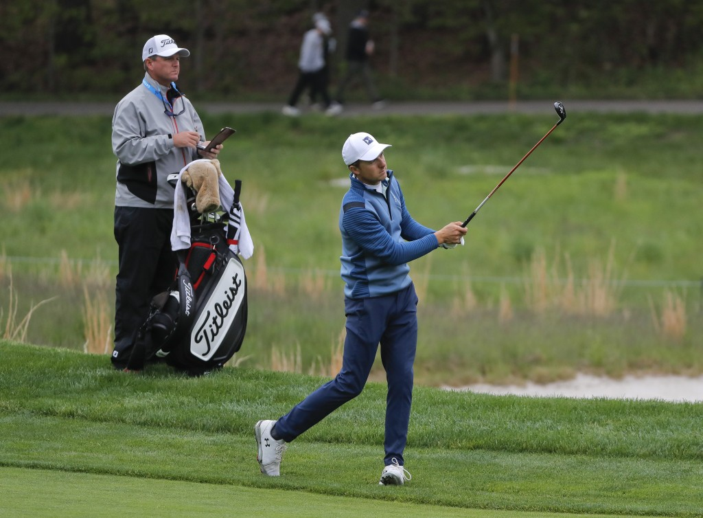 Jordan Spieth follows through on an approach shot on the fourth fairway during a practice round for the PGA Championship golf tournament, Tuesday, May
