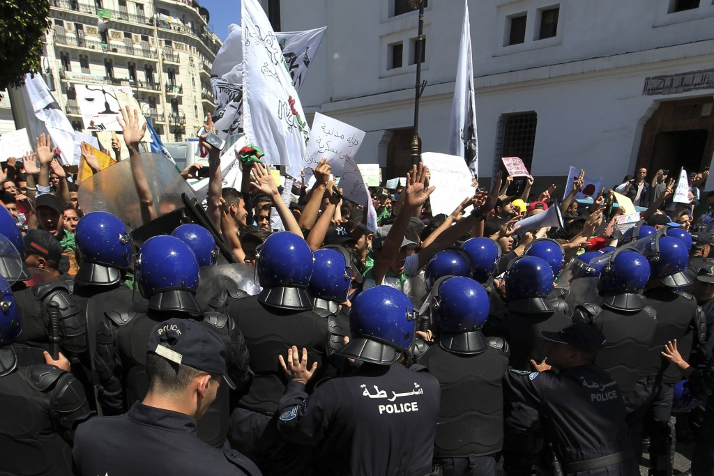 Algerian students face riot police officers during an anti-government demonstration in Algiers, Tuesday, May 14, 2019. Former Algerian President Abdel