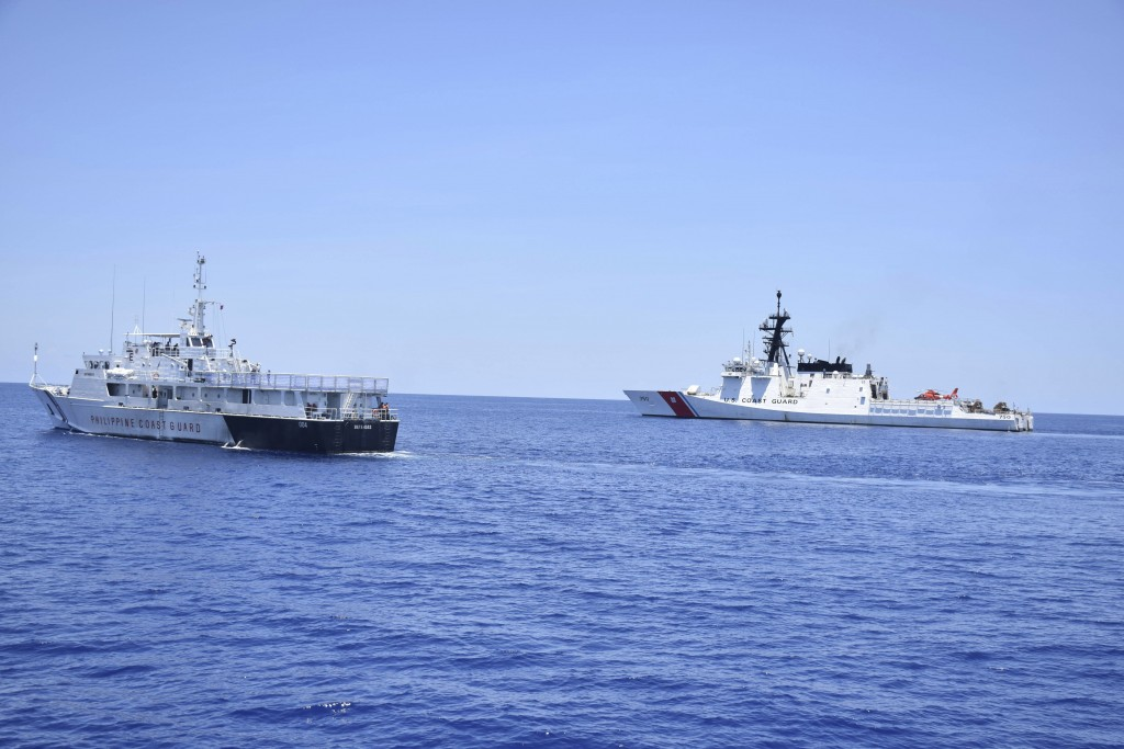 In this May 14, 2019, photo, photo provided by the Philippine Coast Guard, U.S. Coast Guard Cutter Bertholf, right, and Philippine counterpart BRP Bat...