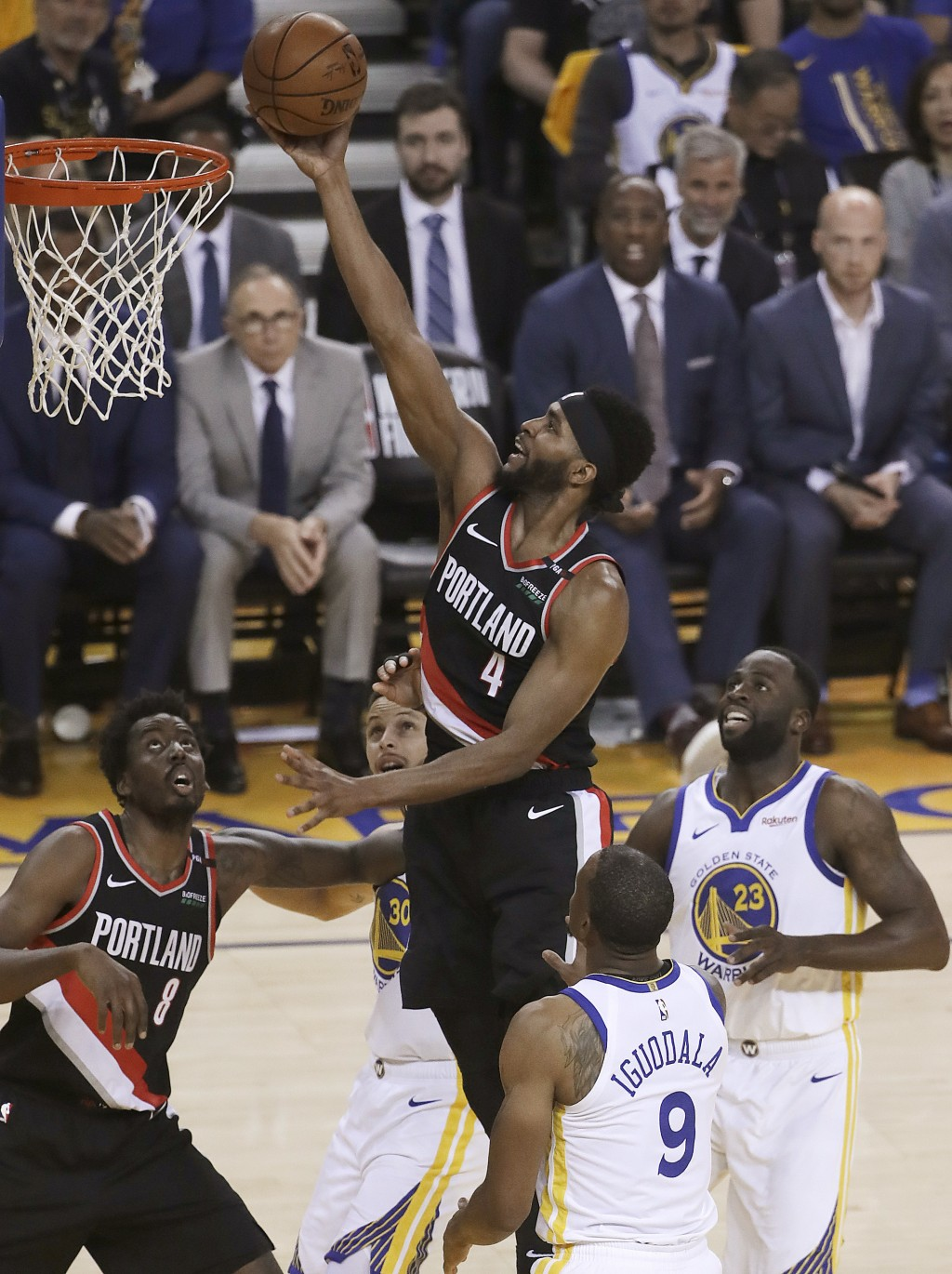 Portland Trail Blazers forward Maurice Harkless (4) shoots against the Golden State Warriors during the first half of Game 1 of the NBA basketball pla...