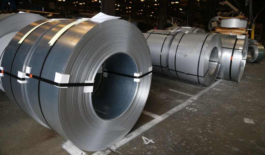 FILE - In this July 11, 2018, file photo rolls of steel sit in a warehouse at a fabrication company in Chester, Va. The 25% tariffs President Donald T