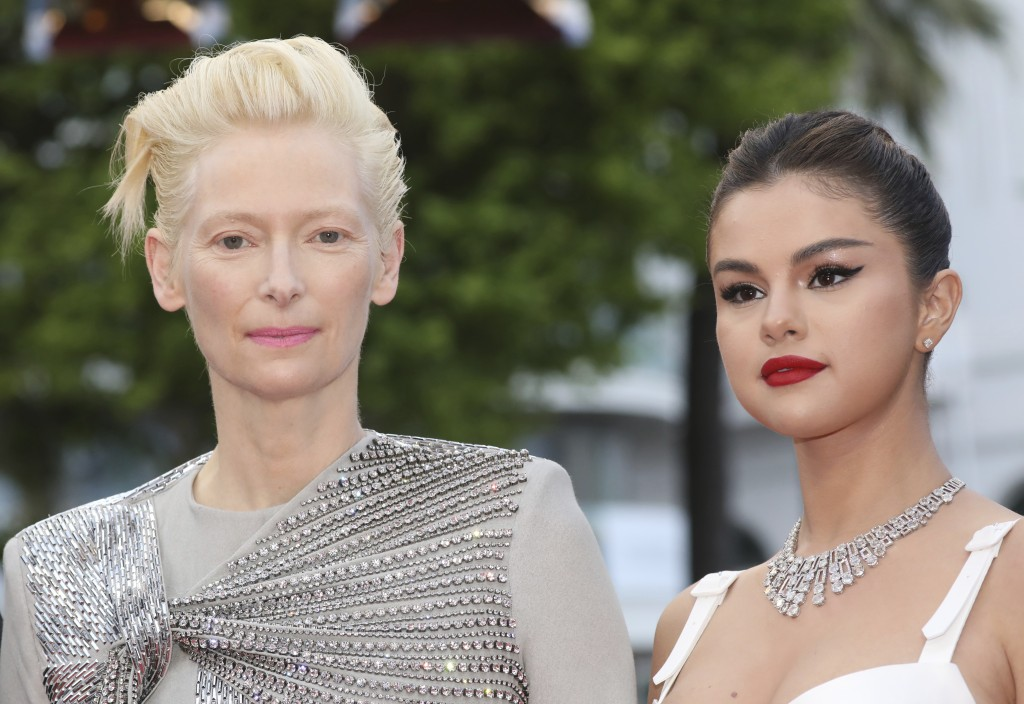 Actresses Tilda Swinton, left, and Selena Gomez pose for photographers upon arrival at the opening ceremony and the premiere of the film 'The Dead Don...