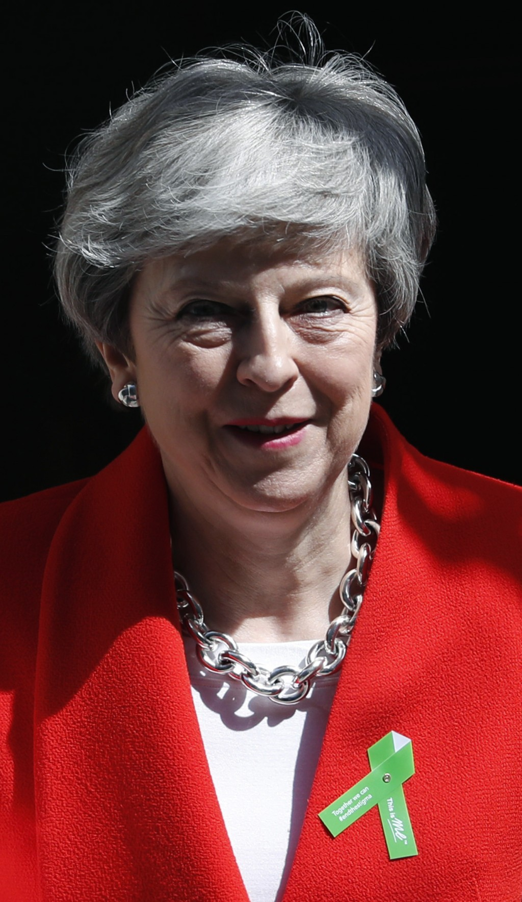 Britain's Prime Minister Theresa May leavse 10 Downing Street for her weekly Prime Minister's Questions at the House of Commons in London, Wednesday,