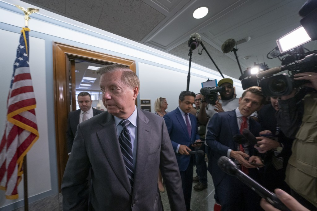 Sen. Lindsey Graham, R-S.C., chairman of the Senate Judiciary Committee, finishes his response to reporters about his earlier advice to Donald Trump J...