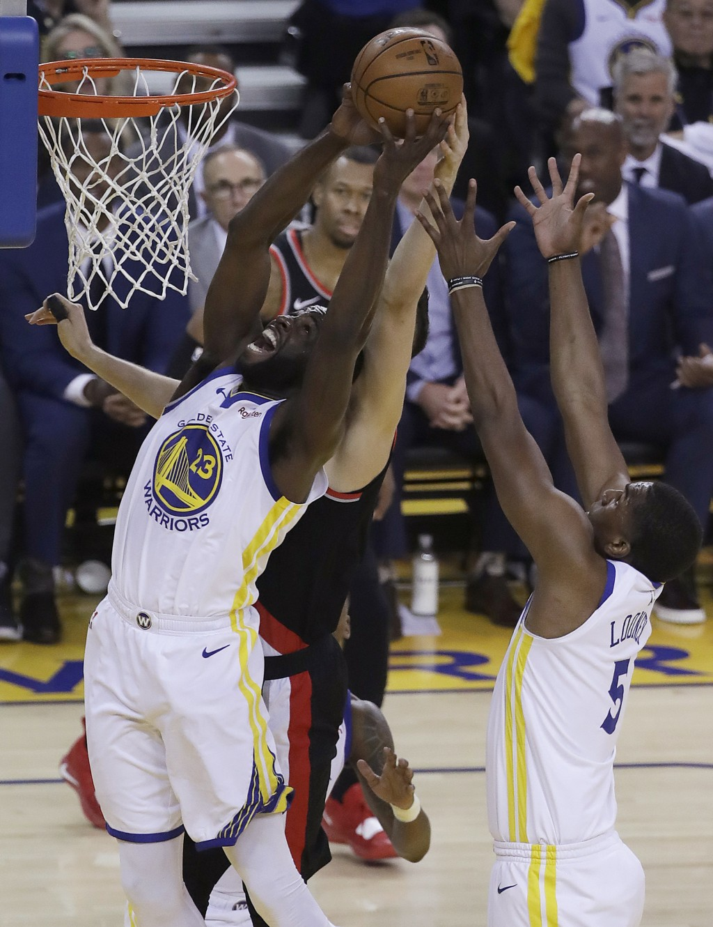 Golden State Warriors forward Draymond Green (23) grabs a rebound against the Portland Trail Blazers during the first half of Game 1 of the NBA basket...
