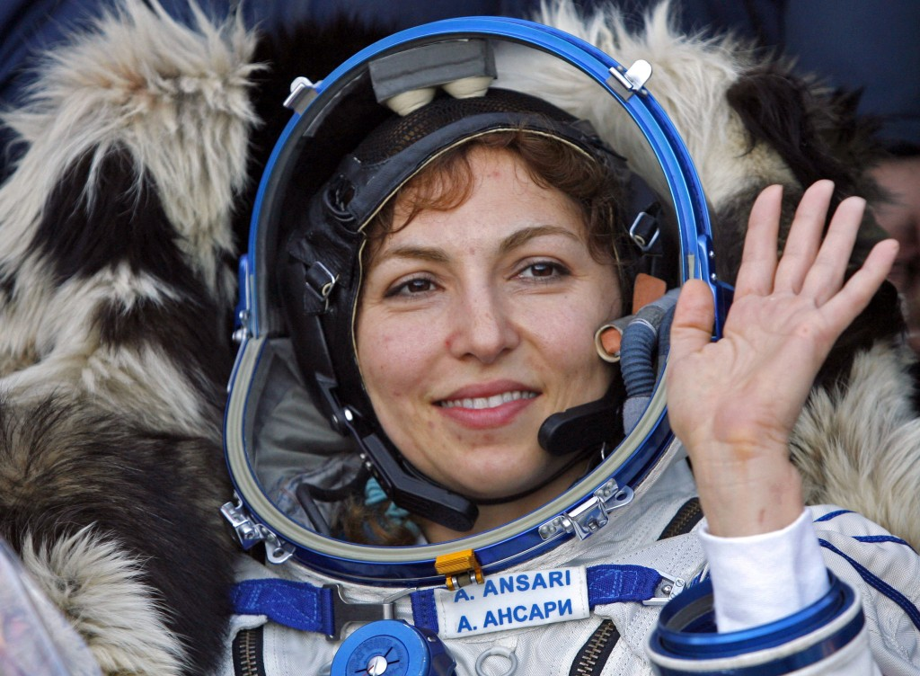 FILE - In this Sept. 29, 2006 file photo, U.S. space tourist Anousheh Ansari waves shortly after landing near the town of Arkalyk, northern Kazakhstan