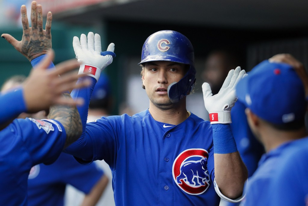 Chicago Cubs' Albert Almora Jr. celebrates in the dugout after hitting a solo home run off Cincinnati Reds starting pitcher Sonny Gray in the fourth i