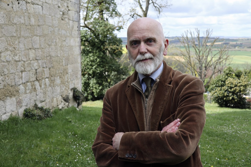 """In this April 4, 2019, photo, a candidate for Europe's legislature Renaud Camus, who coined the term, """"the great replacement,"""" poses for a photo at hi"""