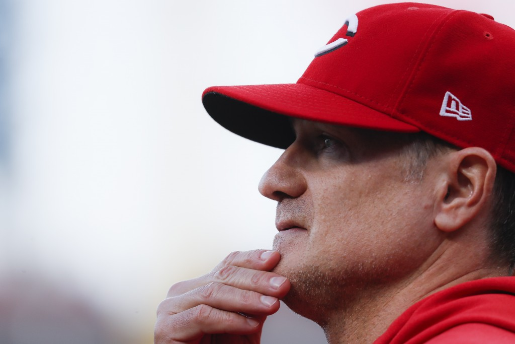 Cincinnati Reds manager David Bell works in the dugout during the fourth inning of a baseball game against the Chicago Cubs, Wednesday, May 15, 2019,