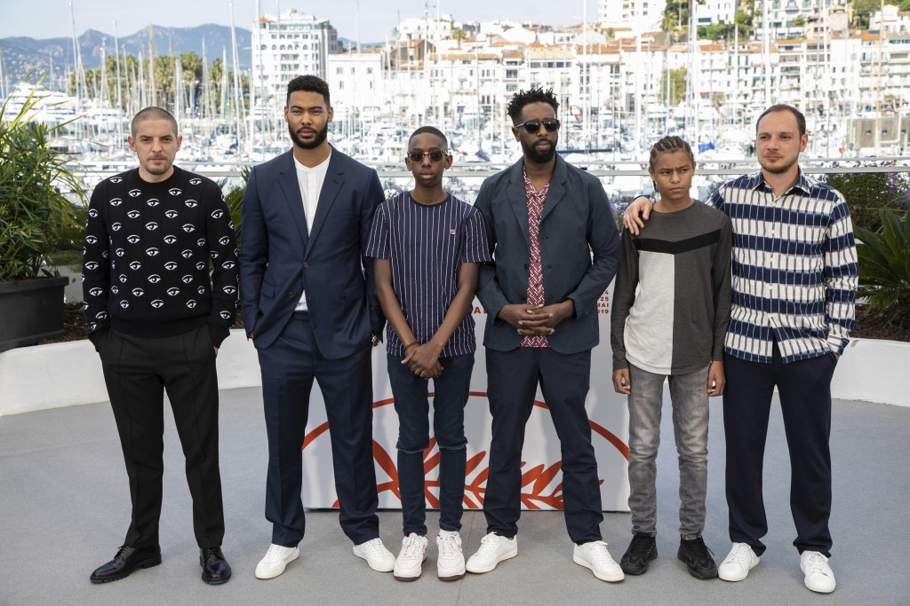Actors Damien Bonnard, from left, Djebril Didier Zonga, Al Hassan Ly, director Ladj Ly, actors Issa Perica and Alexis Manenti pose for photographers a