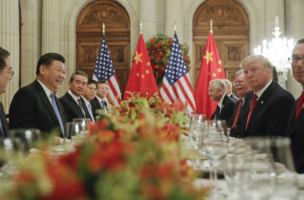 FILE - In this Dec. 1, 2018, file photo, President Donald Trump, second from right, meets with China's President Xi Jinping, second from left, during