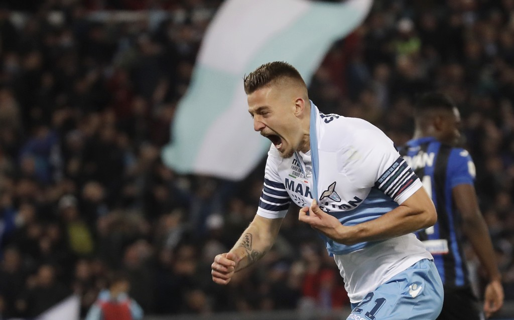 Lazio's Sergej Milinkovic Savic celebrates after scoring his side's opening goal during the Italian Cup soccer final match between Lazio and Atalanta,