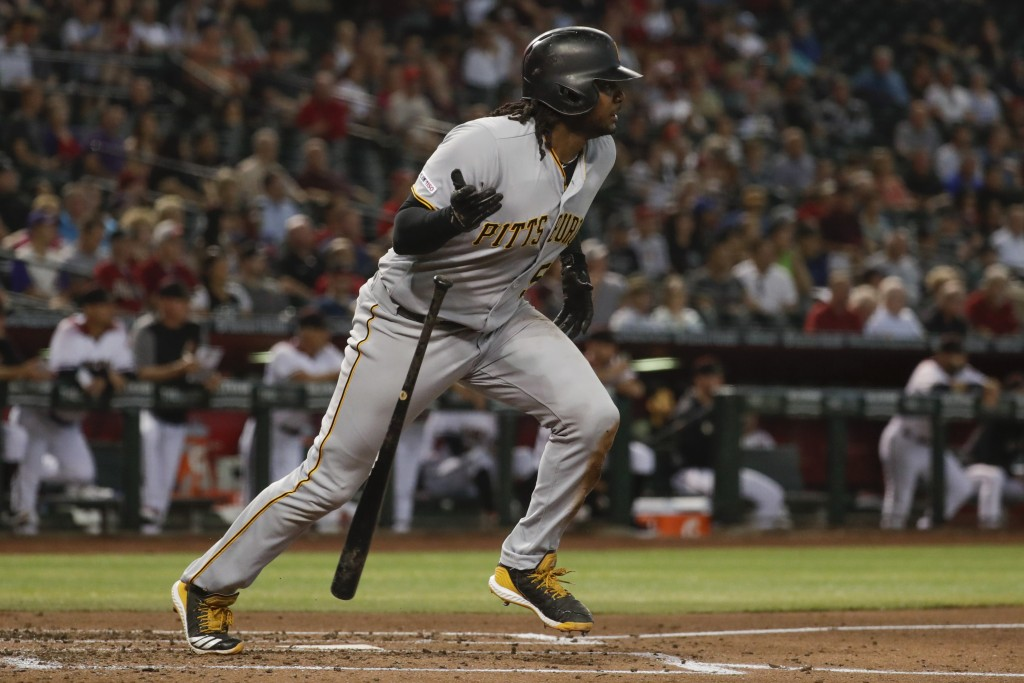 Pittsburgh Pirates' Josh Bell watches his double against the Arizona Diamondbacks during the second inning of a baseball game in Phoenix, Wednesday, M