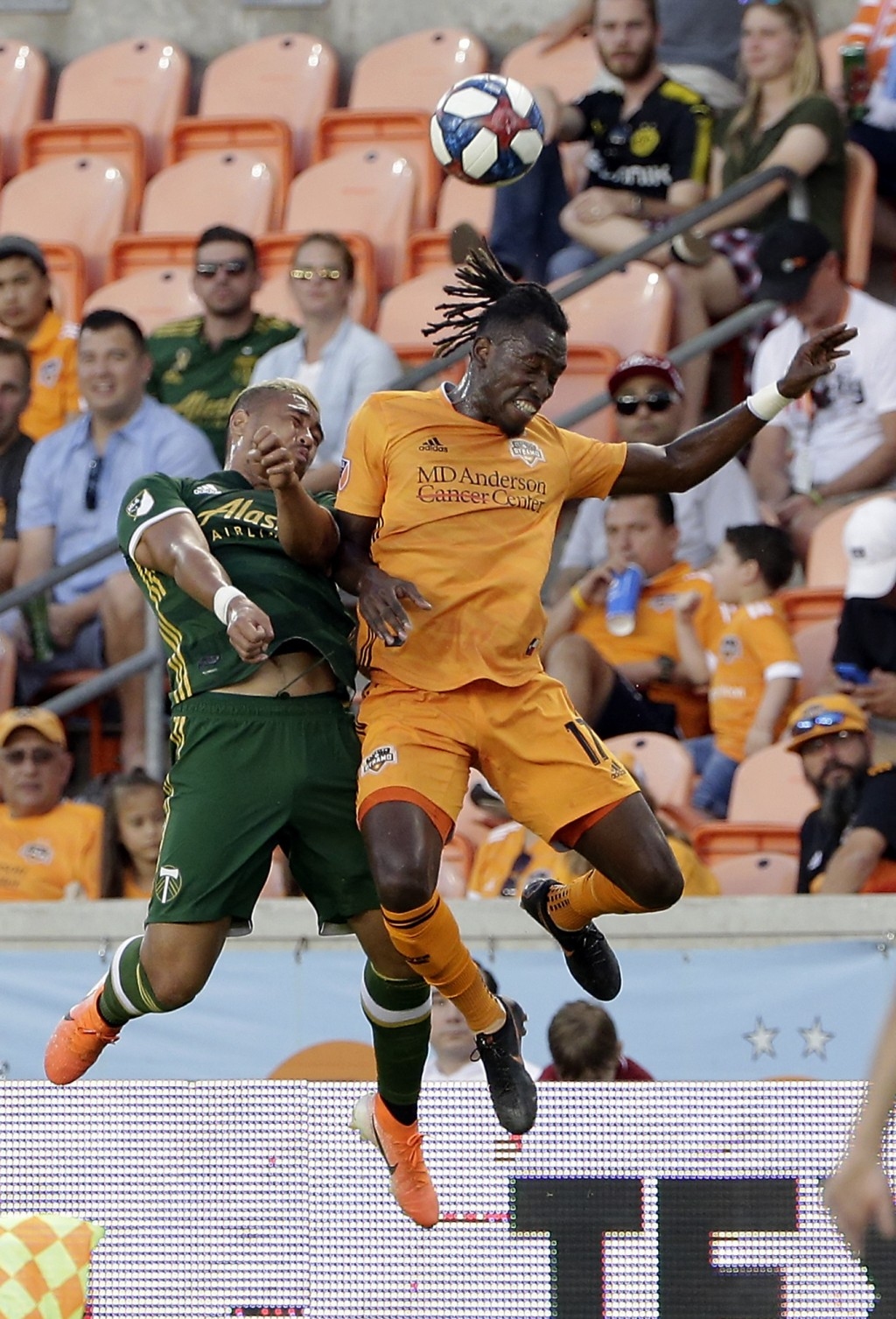 Portland Timbers defender Bill Tuiloma (25) and Houston Dynamo forward Alberth Elis (17) both go up for a head ball during the first half of an MLS so