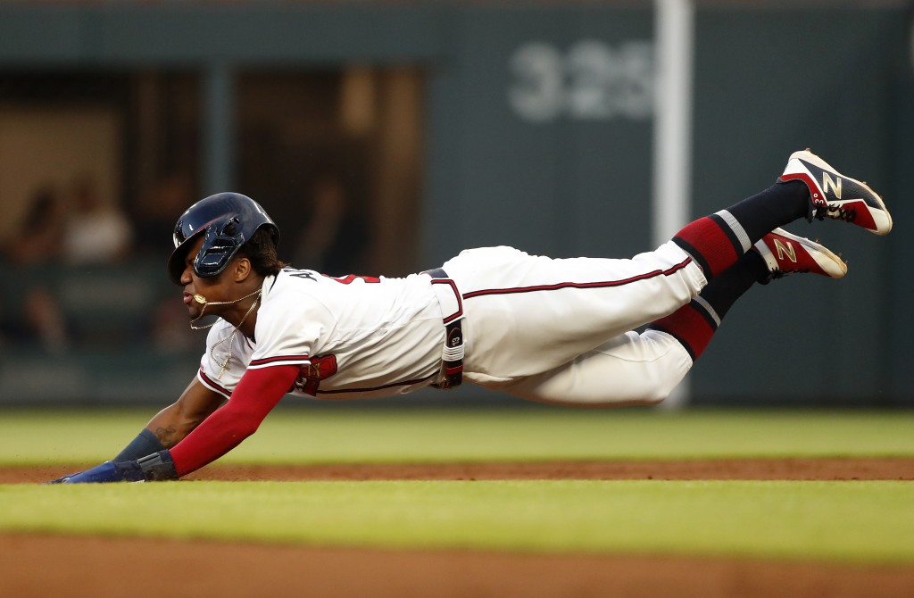 Atlanta Braves' Ronald Acuna Jr. (13) dives head first as he steals second base in the third inning of a baseball game against the St. Louis Cardinals