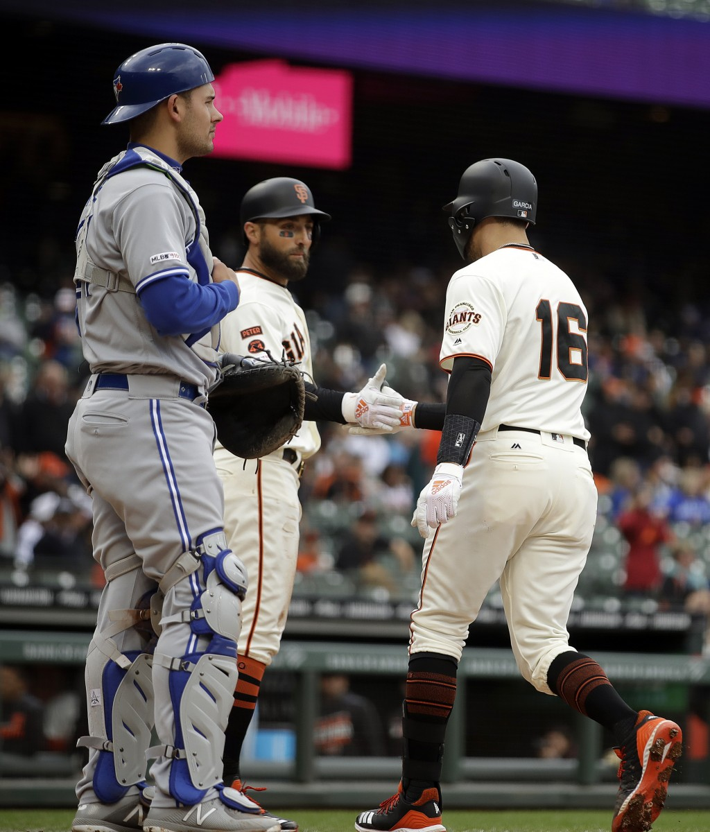 San Francisco Giants' Aramis Garcia (16) is congratulated by Kevin Pillar after hitting a two run home run off Toronto Blue Jays' Edwin Jackson in the