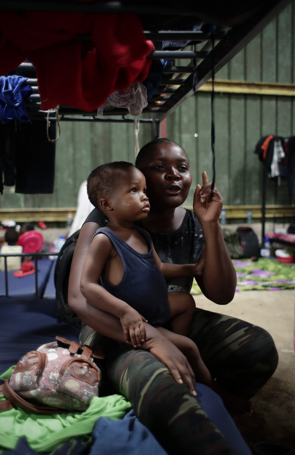 In this May 10, 2019 photo, Hatian migrant Venise Felizor holding her son Wesly Simeon Felizor, speaks during an interview at a shelter in Peñitas, Da